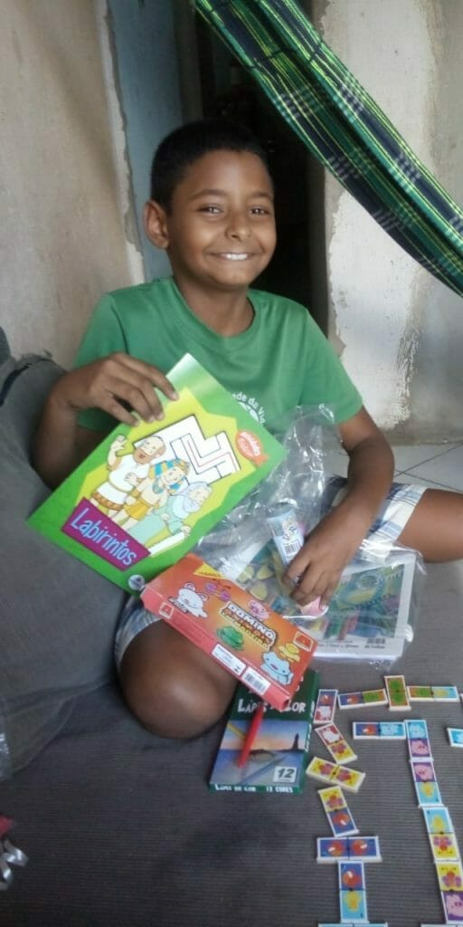 Boy with learning pack